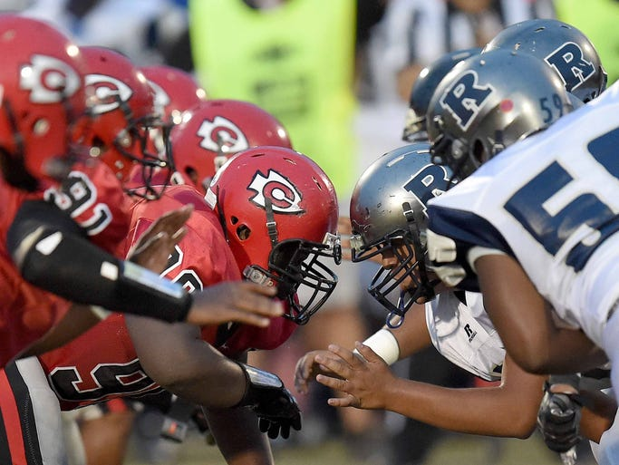 The battle in the trenches between the Clinton Arrows and Ridgeland Titans begins as the ball is snapped on Friday night, August 29, at Clinton High School.