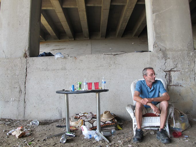 Richmond 'Sapian Docilis' Hurd at his campsite at the 9th Street and Interstate 65 overpass in Jeffersonville, IN. Aug. 14, 2014