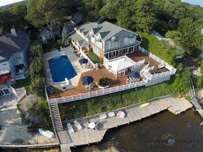 """The Compound"" at 529 Princeton Ave., Brick, sits on a double lot, high atop a bluff overlooking the Metedeconk River."