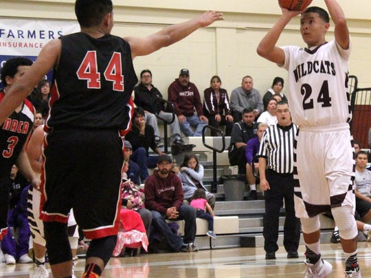 Joe Perez puts up a shot while being defended by Clinton Marmon.