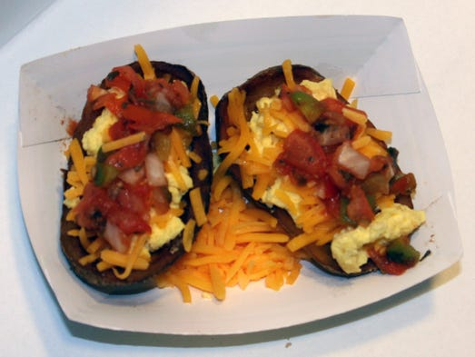 The Three Buck Bowl, two crispy potato skins filled with scrambled eggs, fresh salsa and shredded cheddar cheese. Available at Steer N Stein on the Grand Concourse.