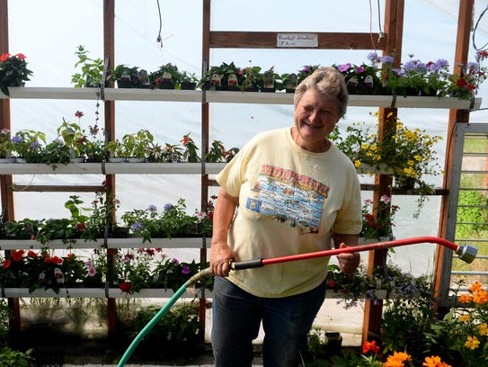 Jennie Graham, owner of Jennie's Greenhouse, grows