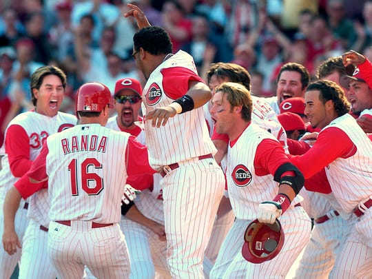 Joe Randa is mobbed by Reds players after his walkoff home run gave the Reds a 7-6 win in 2005.