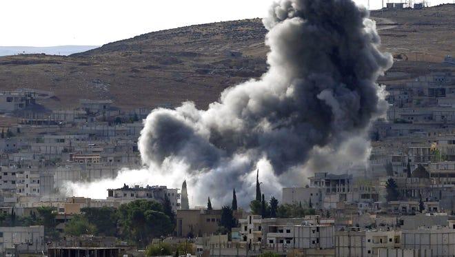 Smoke rises Oct. 15 after an airstrike in Kobani, Syria.