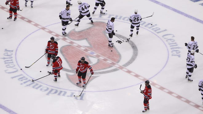 A general view as New Jersey Devils and Los Angeles Kings players warm up over the center ice logo before game one of the 2012 Stanley Cup Finals at the Prudential Center.
