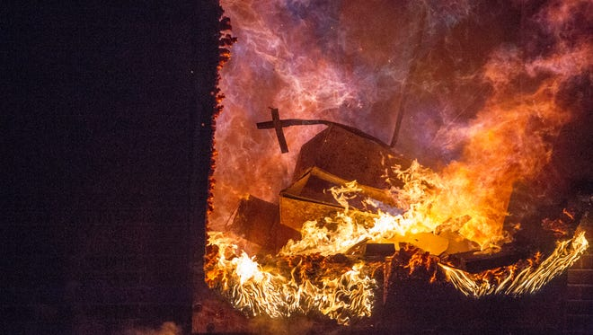 Protesters burn down Jade Nails and several other business during the riot in Ferguson after a grand jury decided not to indict Officer Darren Wilson in the shooting death of Michael Brown.