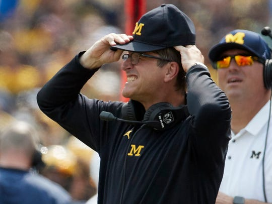 Jim Harbaugh reacts to a play in the second half of