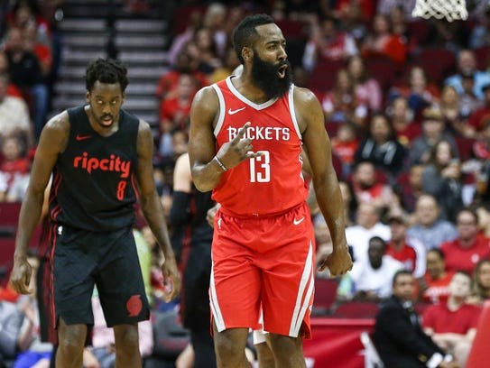 Houston Rockets guard James Harden (13) reacts after