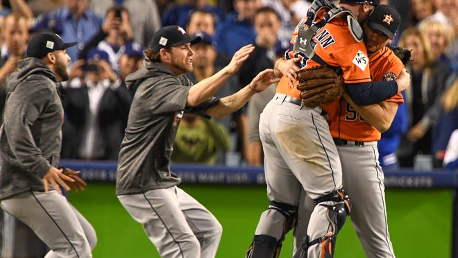 The Houston Astros celebrate after beating the Los Angeles Dodgers in Game 7 of the 2017 World Series at Dodger Stadium.