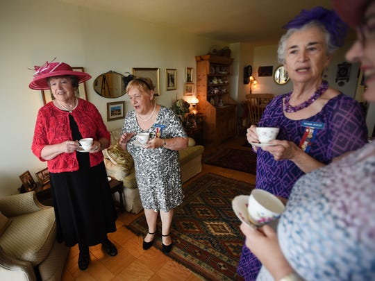 Members of the Daughters of the British Empire, an organization for women of British birth or lineage, (L to R),  Carol Handy of Washington Township and Angela Walsh of Fort Lee, Virginia Bosler of Glen Rock and Jackie Smith of Ridgewood, have tea together as they hold a bridal shower in Fort Lee for the upcoming royal wedding this Saturday.
