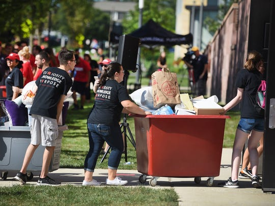 Volunteer students push carts getting into the Rutgers Honors College dormitory during the Rutgers Moving In Day at 5 Seminary Place in New Brunswick on 08/30/18.