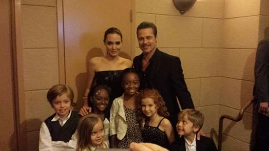 """Angelina Jolie, Brad Pitt and their children Zahara, 9, Shiloh, 8, Vivenne, 5, and her twin brother Knox, and another friend, pose with actress Francesca Capaldi at the premiere of Jolie's new movie """"Maleficent,"""" the big-budget Disney live-action tale (in theaters Friday.) The Jolie-Pitt children are fans of Capaldi's Disney Channel TV show, """"Dog with a Blog."""""""
