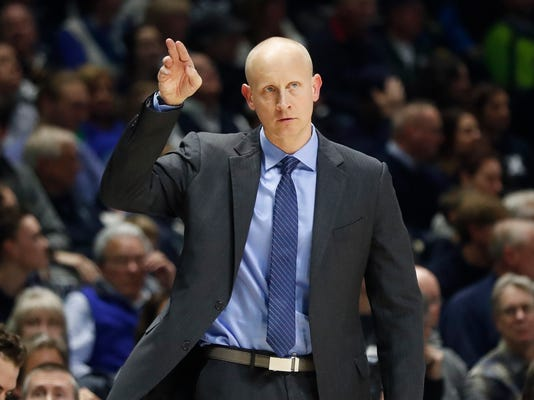 Xavier head coach Chris Mack directs his players from the bench in the second half of an NCAA college basketball game against Butler, Tuesday, Jan. 2, 2018, in Cincinnati. Xavier won 86-79. (AP Photo/John Minchillo)
