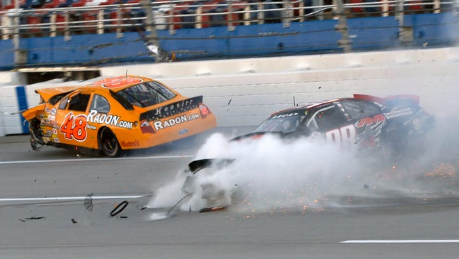 Brad Smith (48) slams into an outside wall after making contact with Austin Wayne Self (98) during an ARCA crash at Talladega Superspeedway.