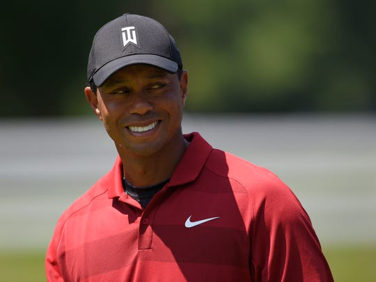 Tiger Woods reacts as he walks on the sixth hole during the final round of the Quicken Loans National golf tournament, Sunday, July 1, 2018, in Potomac, Md. (AP Photo/Nick Wass)