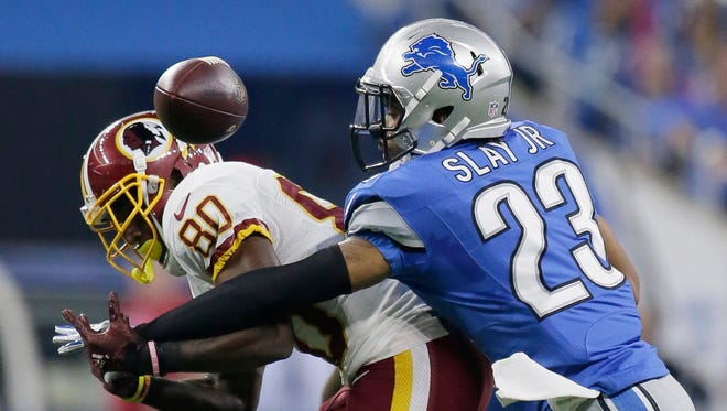 Lions cornerback Darius Slay deflects a pass intended for Washington Redskins receiver Jamison Crowder during the first half Sunday, Oct. 23, 2016 in Detroit.