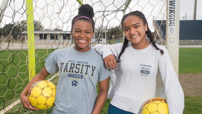 Mya and Aila Swinton pose on the soccer field at Gulf Breeze High School on Wednesday, February 21, 2018.  The Lady Dolphins will face Merritt Island during the Class 3A state championship game in DeLand on Friday, February 23rd.