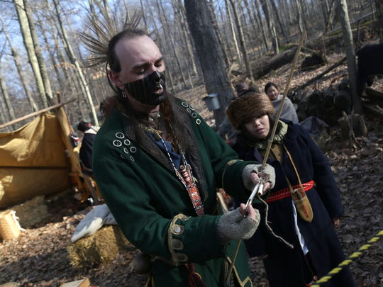 Jeremy Moore demonstrates how Native Americans harvested maple syrup before the Europeans came during the Maple Syrup Festival at Malabar Farm on Saturday afternoon.
