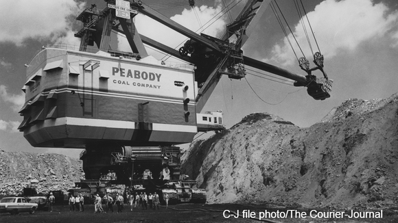 Dignitaries walk away from Peabody Coal company's giant shovel at a mine in western Kentucky in August 1965.