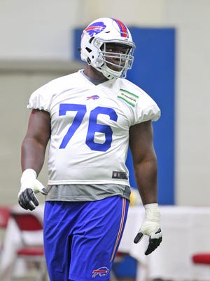 The Buffalo Bills have signed third-round draft pick John Miller, a guard out of Louisville.