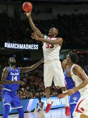 Arkansas forward Moses Kingsley (33) shoots near Seton Hall forward Ismael Sanogo (14) during the first half of the 2017 NCAA Greenville 1st/2nd Rounds on Friday at Bon Secours Wellness Arena in Greenville.