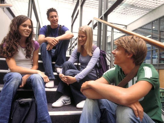 Classmates socializing on staircase
