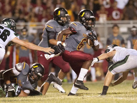 Romello Harris rumbles for yardage in the Tulare Union