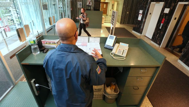 A security guard in the lobby of Rockland County's Allison-Parris office building in New City Dec. 29, 2015.