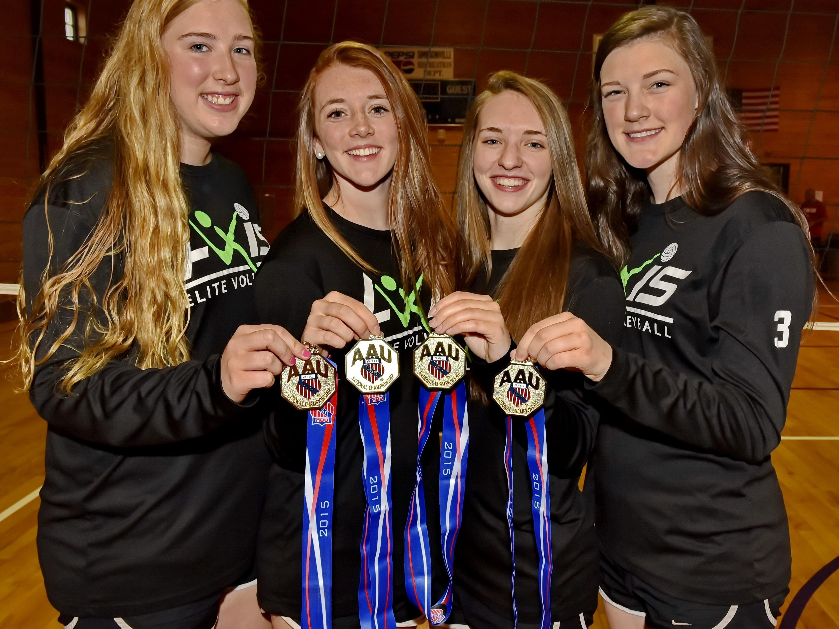 From left, Allie Wright, Christina Ellwanger, Kaely Thompson and Allison Whitten served as captains on the Simpsonville-based Axis 16 Rox team that won the AAU National Junior Volleyball Championship in the 16 Premier Division June 26 in Orlando, Florida.