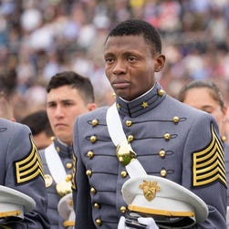 In a photo shared on the West Point Military Academy's Facebook, tears stream down 2nd Lt. Alix Schoelcher Idrache's face as he stands with his alongside his peers at a graduation ceremony on May 21.