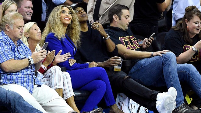 Recording artists Beyonce and Jay Z during the first quarter game six of the NBA Finals between the Golden State Warriors and the Cleveland Cavaliers at Quicken Loans Arena.