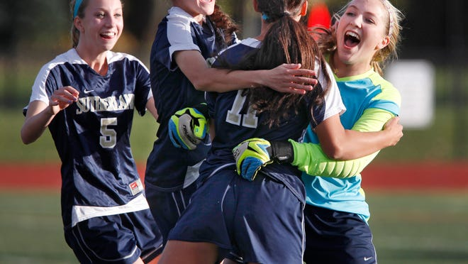 From the left, Emma Tenhoopen, Grace Dunnigan, Vicki Beatham and goalie Lauren Graupman celebrate Pittsford Sutherland's Class A quarterfinal win over Brighton on Monday. The Knights won on penalty kicks that went 13 rounds. The game started on Saturday but was suspended because of lightning. It resumed Monday and it was a goal by Beatham, second from right, that clinched the victory.