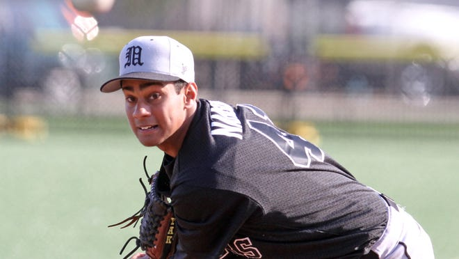 Mamaroneck's Kumar Nambiar gave up two hits over eight shutout innings as Mamaroneck defeated New Rochelle 2-1 in nine innings in a varsity baseball game at City Park in New Rochelle April 21, 2015. Nambiar struck out 14 batters.