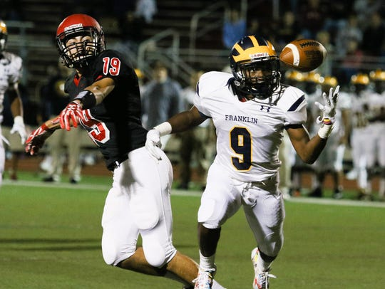 Franklin's Tayo Badru (right) intercepts the pass by