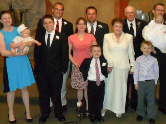 Mary and Walter Morris renewed their vows in May 2013. The same day, their twin grandchildren were christened.