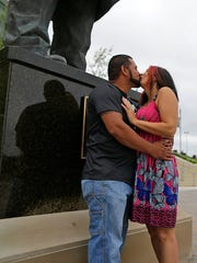 Raul Rodriguez, from Pharr, Texas, kisses his new fiancé Elizabeth Moore, from Mobile, Ala., next to the Vince Lombardi statue at Lambeau Field in Green Bay on June 16. Rodriguez proposed to Elizabeth inside the Lambeau Field Atrium that day. The couple, who work for the same company, were visiting the stadium during their family vacation.