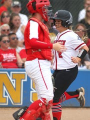 Cardington's Baylee Adams (2) scores in the first inning