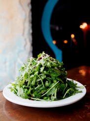 Zambra's baby arugula salad, tossed with shavings of