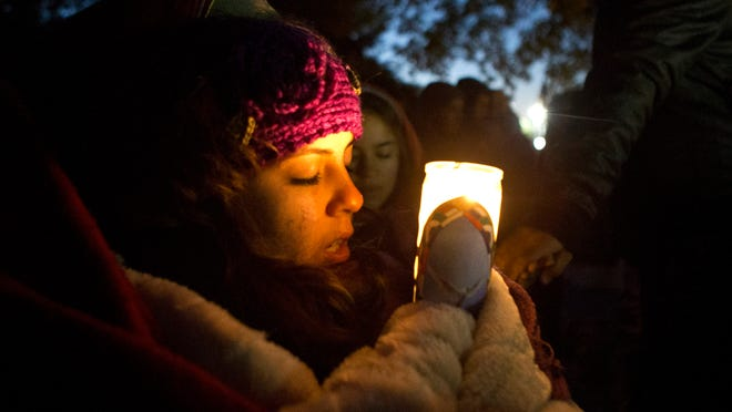 Arizonan Anakarina Rodriguez and other immigration-reform supporters gathered in October outside the home of House Speaker John Boehner, R-Ohio, to pray for a comprehensive bill. Advocates still cling to the possibility a bill could pass this year.