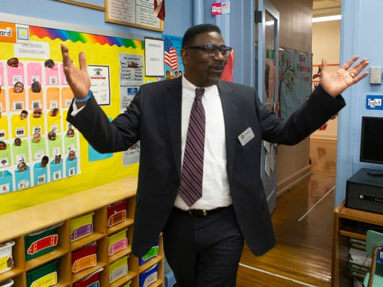 Milwaukee Public Schools Interim Superintendent Keith Posley enters a classroom at Clarke Street School to meet with staff and students.