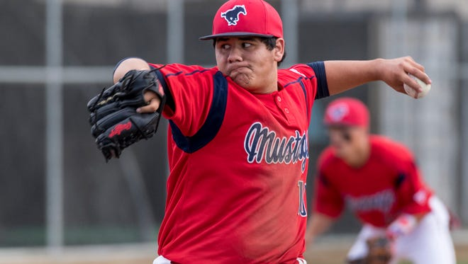 Tulare Western's Izaiah Davis pitches against Delano in an East Yosemite League high school baseball opener on Wednesday, March 14, 2018.