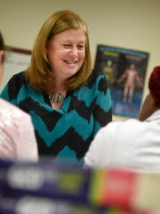 IU-13 instructor Lynn Campbell works with students
