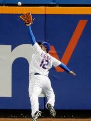 New York Mets center fielder Juan Lagares (12) catches a ball hit by San Diego Padres' Erick Aybar for an out during the eighth inning of a baseball game Wednesday, May 24, 2017, in New York.