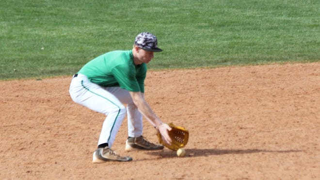 Shortstop Cade Anderson fields a grounder during infield practice on Saturday morning at VVHS.