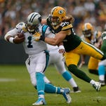 Packers receiver Jordy Nelson runs away from the Panthers defense during their 2011 game.