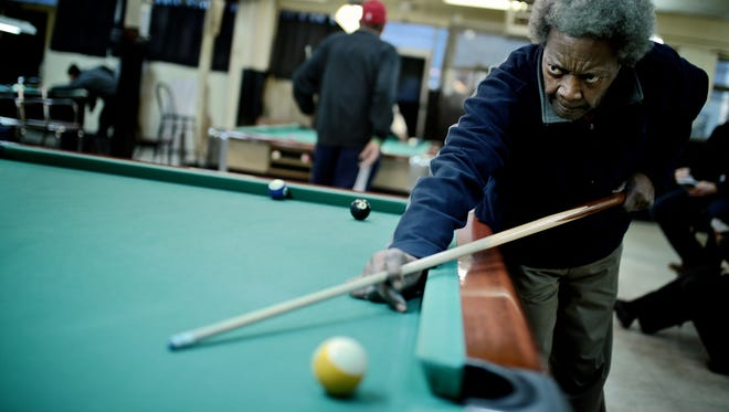 Homr Ross, 73, of Detroit, aims during a game of pool at Bill's Recreation on Friday, February 5, 2016, in Detroit.