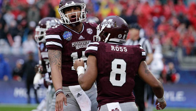 The Clarion-Ledger's Michael Bonner discusses all things Mississippi State including Dak Prescott (left) and Fred Ross coming up at 1 p.m. on Periscope.