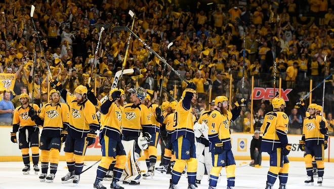 The Predators raise their sticks after the series-clinching win in Game 6 of the second round series May 7, 2017.