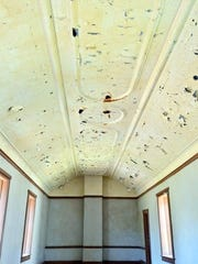 The tin ceiling in the chapel at Fort Stanton needs repair.