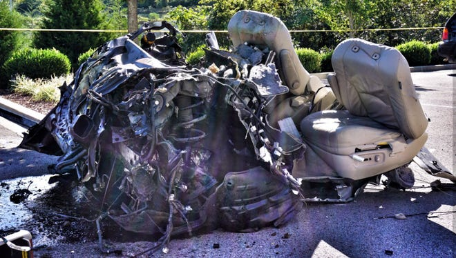 Parts belonging to a Lexus SUV that crashed along I-65 South at McEwen Drive on Tuesday, Sept. 27, 2016